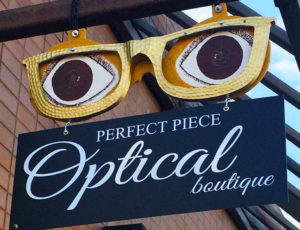 Exterior East-facing sign, over entrance of Perfect Piece Optical Boutique, Mission BC Canada